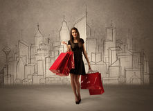 Shopping girl with bags in drawn city royalty free illustration