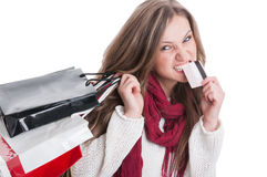 Shopping girl bitting from credit card Stock Photo