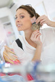 Shopping girl buying earrings Stock Image