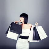 shopping girl carrying new bags Royalty Free Stock Photo