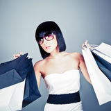 shopping girl carrying new bags Stock Images