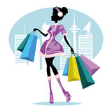 Shopping girl in city Stock Images