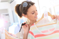 Shopping girl during clothing summer sales Royalty Free Stock Photo