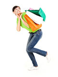 Shopping girl with colourful bags Stock Images