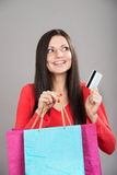 Shopping girl with a credit card Royalty Free Stock Photos