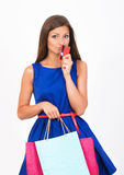 Shopping girl with a credit card Stock Photos