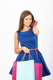 Shopping girl with a credit card Stock Image