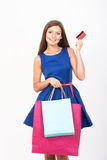 Shopping girl with a credit card Stock Images