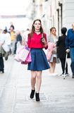 Shopping girl with a drink going through the streets of Italy. Royalty Free Stock Photos