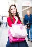 Shopping girl with a drink going through the streets of Italy - close up Royalty Free Stock Photos