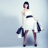 Shopping girl holding bags Stock Photos