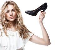 Shopping girl holding a black high heel s Stock Photo