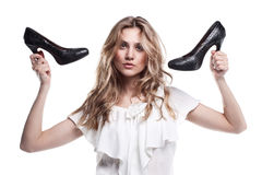 shopping girl holding a black high heel shoe  Royalty Free Stock Images
