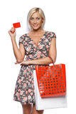 Shopping girl holding empty credit card Stock Photography