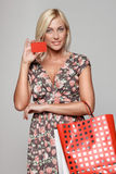 Shopping girl holding empty credit card Royalty Free Stock Images
