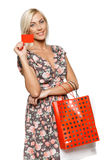 Shopping girl holding empty credit card Stock Image