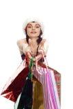 Shopping Girl In Santa Red Cap Royalty Free Stock Photo