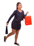 Shopping girl in joy running holding bag Stock Photos