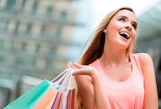 Shopping girl looking up Stock Images