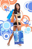 Shopping girl over abstract background Stock Image