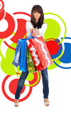 Shopping girl over abstract background Royalty Free Stock Photography