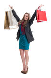 Shopping girl raising hands up in the air stock photo