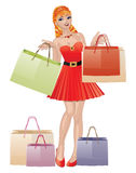 Shopping girl with red hair Royalty Free Stock Photo