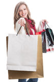 Shopping girl showing paper bags Stock Image