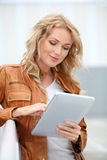 Shopping girl with tablet Stock Photography