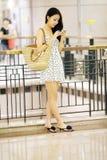 Shopping girl texting Royalty Free Stock Photo