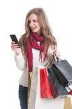Shopping girl texting Royalty Free Stock Photos