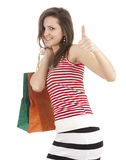 Shopping girl with thumb up Stock Photography