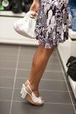 Shopping girl on tiptoe Stock Image