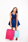 Shopping girl. Tired girl with the shopping bags Stock Images