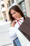 Shopping girl in town Stock Images