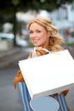 Shopping girl in town Royalty Free Stock Images