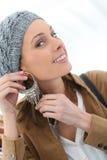 Shopping girl trying on earrings Stock Photos