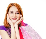Shopping girl in violet with bag. Royalty Free Stock Image