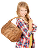 Shopping girl with wicker basket Stock Images