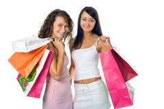 Shopping girlfriend. Shopping beauty girlfriend with colored package over white background royalty free stock photography
