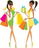 Shopping girls. Two happy girls after shopping Royalty Free Stock Photo