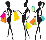 Shopping girls. Silhouettes of  girls with colorful  shopping paper bags Stock Images