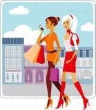 Shopping girls. Stylish ladies walking down the street Stock Images