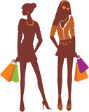 Shopping girls. Two colorful Shopping girls silhouettes Stock Image