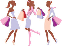 Shopping girls. Young girls silhouettes with shopping bags Royalty Free Stock Images
