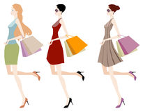 Shopping girls. Beautiful girls with shopping bag Royalty Free Stock Images