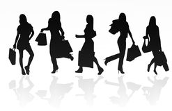Shopping girls. Silhouettes of shopping girls,isolated on white background Royalty Free Stock Images