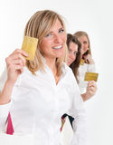 Shopping girls armed with credit cards Royalty Free Stock Photos