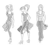 Shopping girls. Black and white illustration of shopping girls on white background Stock Photo