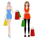 Shopping girls. Fashion shopping girls. Girls  holding shopping bags Stock Photo